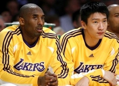 Los Angeles Lakers' Sun Yue and Bryant watch their NBA basketball game against New York Knicks in Los Angeles